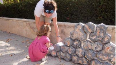 Los más pequeños aprenden en Palma a hacer 'margers de pedra en sec'