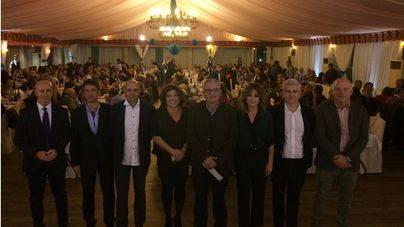Los líderes del partido ante sus invitados