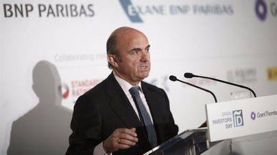 Guindos no ve las condiciones para que BMN y Bankia se puedan fusionar en 2017