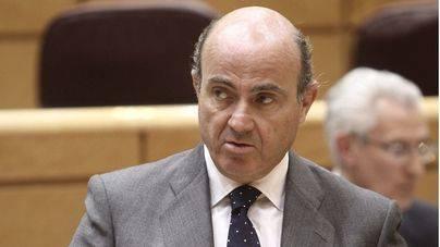 De Guindos asegura que la fusión de Bankia y BMN