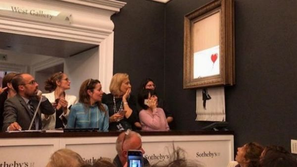 La obra más famosa de Banksy se autodestruye tras ser subastada por más de un millón de euros