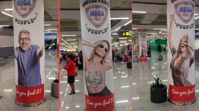 Megapark forra las columnas de Llegadas con fotos de sus empleados para dar la bienvenida a los turistas