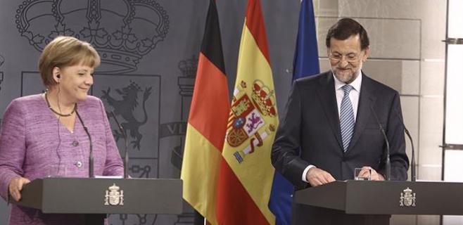 Merkel apoyará a Luis de Guindos a presidir el Eurogrupo